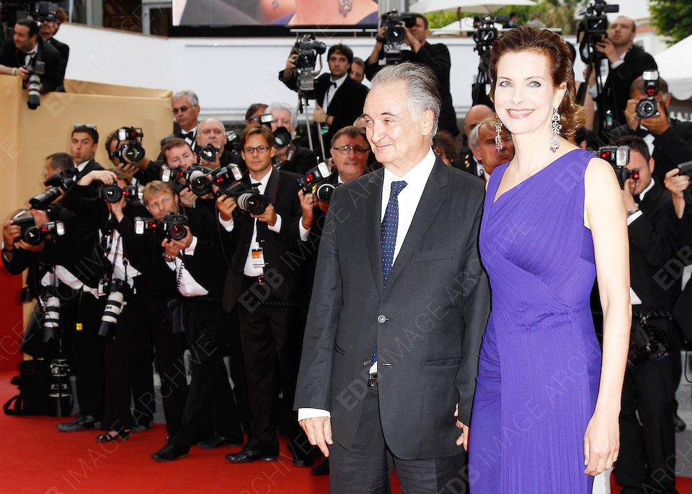 12.MAY.2011. CANNES<br /> <br /> JACQUES ATTALI AND CAROLE BOUQUET ARRIVING ON THE RED CARPET FOR THE SLEEPING BEAUTY PREMIERE AT THE 64TH CANNES INTERNATIONAL FILM FESTIVAL 2011 IN CANNES, FRANCE.<br /> <br /> BYLINE: EDBIMAGEARCHIVE.COM<br /> <br /> *THIS IMAGE IS STRICTLY FOR UK NEWSPAPERS AND MAGAZINES ONLY*<br /> *FOR WORLD WIDE SALES AND WEB USE PLEASE CONTACT EDBIMAGEARCHIVE - 0208 954 5968*