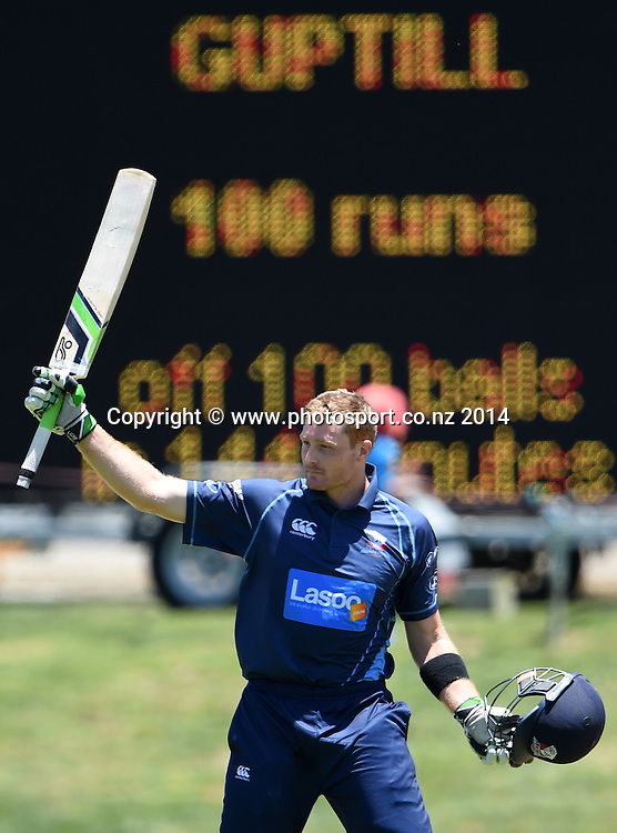 Auckland's Martin Guptill celebrates his century during the Ford Trophy one day cricket match between Auckland Aces and Wellington Firebirds at the Eden Park Outer Oval, Auckland, New Zealand. Saturday 27 December 2014. Photo: Andrew Cornaga/www.Photosport.co.nz
