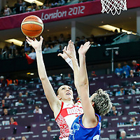 09 August 2012: Russia Irina Osipova goes for the skyhook against Elodie Godin during 81-64 Team France victory over Team Russia, during the women's basketball semi-finals, at the 02 Arena, in London, Great Britain.