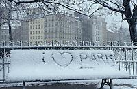 "sign in the snow near Notre Dame, ""I love Paris"" - photograph by Owen Franken"