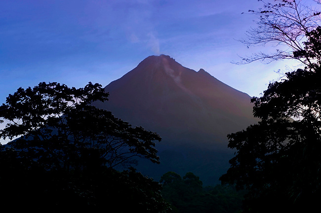Early Morning Sun Strikes The Top Of The Very Active Arenal Volcano In La Fortuna, Costa Rica.