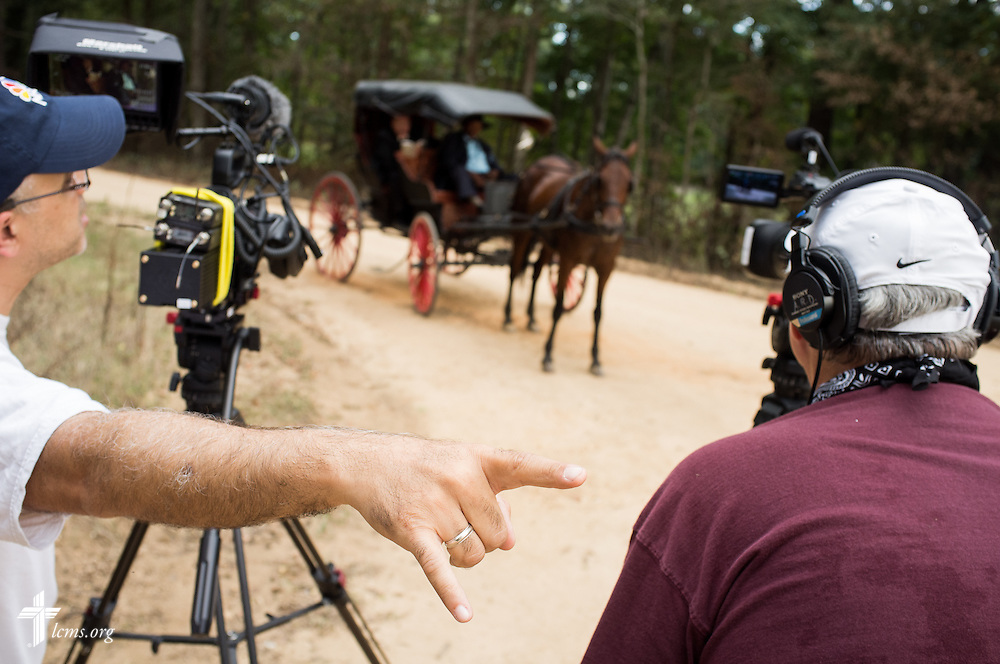 Ben DeSousa, director of photography (left) instructs the driver of a horse for a scene during the final day of filming for 'The First Rosa' documentary on Thursday, September 25, 2014, near Selma, Ala.  LCMS Communications/Erik M. Lunsford