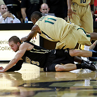 Central Florida guard A.J. Rompza (3) scrambles for the ball against Shedrick Haynes (11) during the NCAA basketball game against the USF Bulls at the UCF Arena on November 18, 2010 in Orlando, Florida. UCF won the game 65-59. (AP Photo/Alex Menendez)