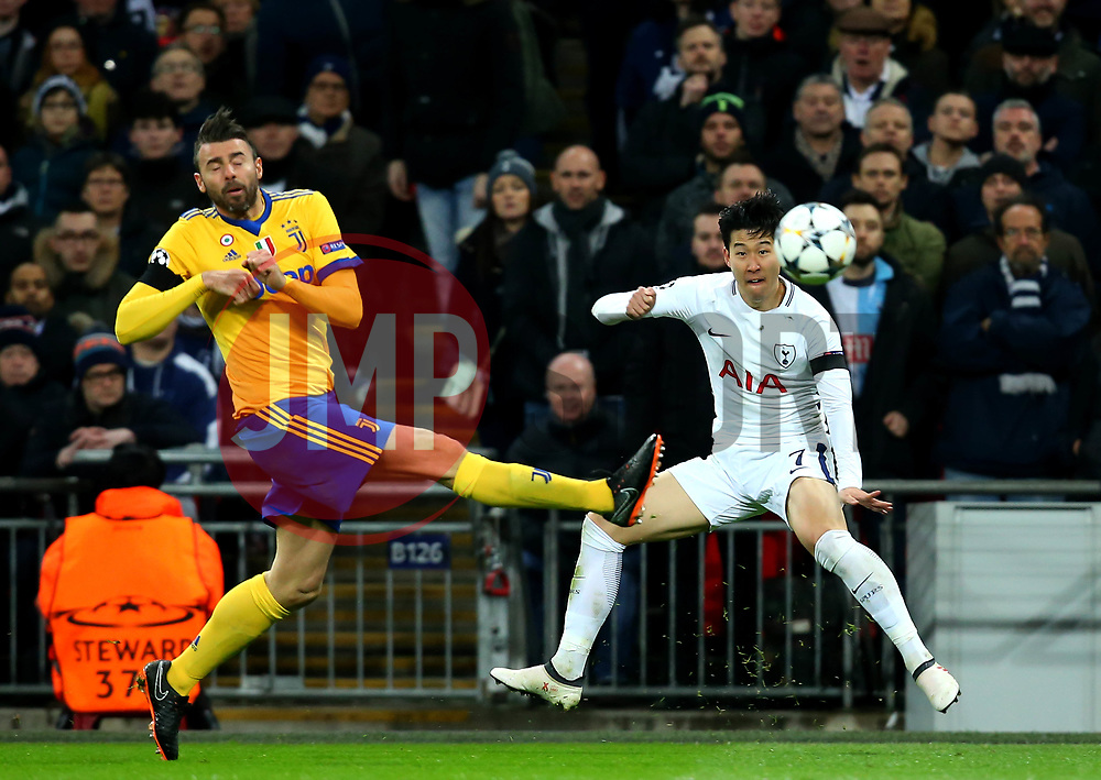 Son Heung-Min of Tottenham Hotspur crosses the ball past Andrea Barzagli of Juventus  - Mandatory by-line: Robbie Stephenson/JMP - 07/03/2018 - FOOTBALL - Wembley Stadium - London, England - Tottenham Hotspur v Juventus - UEFA Champions League, Round of 16, second leg