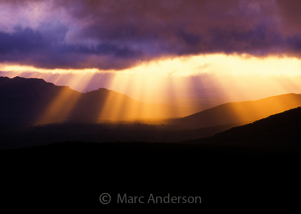 Sun beams breaking through storm clouds, Grampians National Park, Australia.
