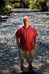 Farrera, Lleida,Spain<br /> Colm Toibin,writer, inside the river.<br /> &copy;Carmen Secanella