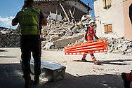 Civil protection members preparing a coffin near some demolished houses in Saletta. A 6,4 earthquake has hit central Italy during the night between the 23 and 24 August killing more than 100. The town of Amatrice is been heavily damaged.
