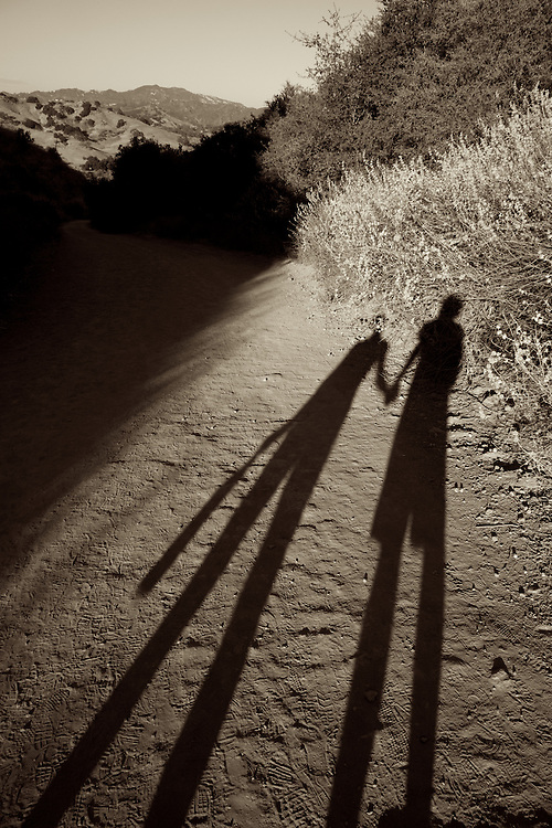 Shadows of Hagar and Andrew, hiking at sunset, Malibu, Summer 2010.