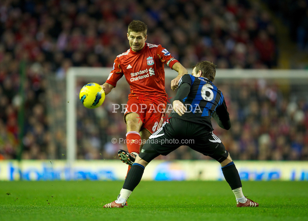 LIVERPOOL, ENGLAND - Saturday, January 14, 2012: Liverpool's captain Steven Gerrard in action against Stoke City's Glenn Whelan during the Premiership match at Anfield. (Pic by David Rawcliffe/Propaganda)