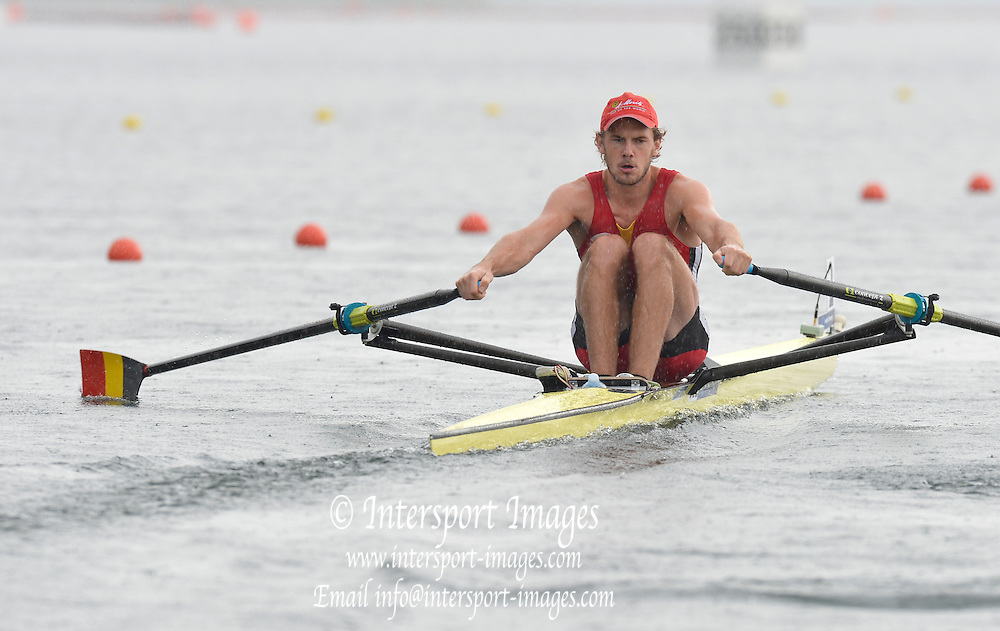 Trackai. LITHUANIA.  BEL BM1X, Hannes OBRENO waits in the rain for the start of his heat, Start, Heats. 2012 FISA U23 Rowing Championships, Lake Galve.   13:28:08 Thursday 12/07/2012 [Mandatory credit: Peter Spurrier/Intersport Images]..Rowing, U23, 2012.