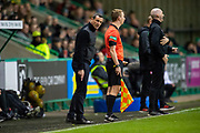 Hibernian FC manager, Jack Ross speaks to the stand side assistant referee during the Ladbrokes Scottish Premiership match between Hibernian FC and Hamilton Academical FC at Easter Road Stadium, Edinburgh, Scotland on 22 January 2020.