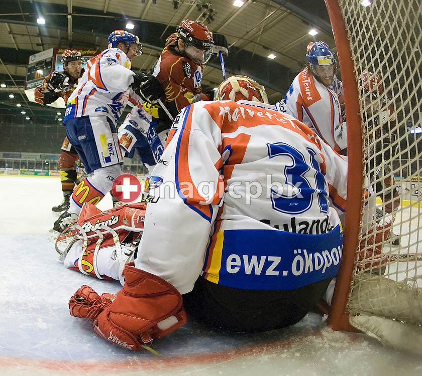 (L-R) Geneva's Martin Hohener, Zurich's Mathias Seger, Geneva's Laurent Meunier, Goaltender Ari Sulander (on the ground) of the ZSC Lions and Zurich's Severin Blindenbacher fight for the puck during the Swiss NHL Play-Off final ice hockey game between Geneve-Servette HC and ZSC Lions held at the Les Vernet arena in Geneva, Switzerland, Thursday, April 3, 2008. Geneve-Servette HC loses 3:2 but still leads the best of 7 series by 2:1. (Photo by Patrick B. Kraemer / MAGICPBK)