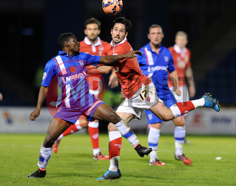 Bristol City's Greg Cunningham challenges for the header with Gillingham's Jermaine McGlashan - Photo mandatory by-line: Dougie Allward/JMP - Mobile: 07966 386802 - 08/11/2014 - SPORT - Football - Gillingham - Priestfield Stadium - Gillingham v Bristol City - FA Cup - Round One