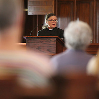 All Saints Episcopal Church Rev. Ann Whitaker delivers the Homily during their Good Friday service Friday afternoon.