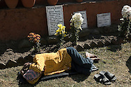 A resident of Nava Kiran + hospice taking a nap by a memorial to deceased of the hospice, who died of HIV related diseases. The hospice has about 50 residents 20 of which receive a anti-retroviral therapy and 5 are treated for tuberculosis. Nava Kiran + is a NGo run by former drug users focussing on drug users and focussing on HIV prevention, access to therapy, rehabilitation of addicts.