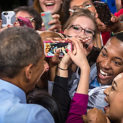 President Barack Obama, left, greeted visitors following his speech at Anschutz Sports Pavillion on the University of Kansas campus in Lawrence.