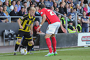 Burton Albion midfielder on loan from Birmingham City Mark Duffy takes on Coventry City defender Aaron Martin during the Sky Bet League 1 match between Burton Albion and Coventry City at the Pirelli Stadium, Burton upon Trent, England on 6 September 2015. Photo by Simon Davies.