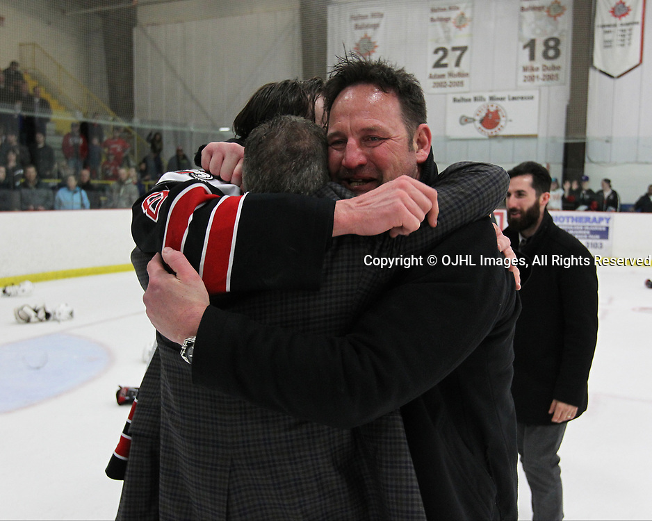 GEORGETOWN, ON  - APR 26,  2017: Ontario Junior Hockey League, Championship Series. Georgetown Raiders vs the Trenton Golden Hawks in Game 7 of the Buckland Cup Final. Coach Walters, Team Owner Bill Court and his son Andrew Court #88 embrace and celebrate their Buckland Cup Win.<br /> (Photo by Tim Bates / OJHL Images)