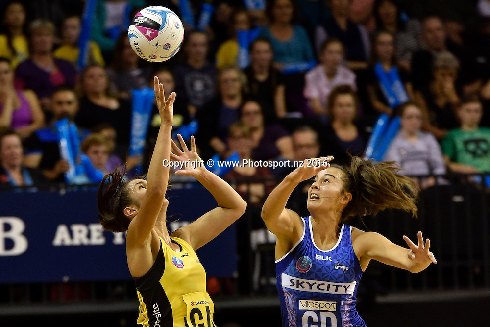 Pulse's Ameliaranne Wells (L) jumps for a pass with Mystics' Holly Fowler during the ANZ Champs - Pulse v Mystics netball match at TSB Arena in Wellington on Monday the 18 April 2016. Copyright Photo by Marty Melville / www.Photosport.nz