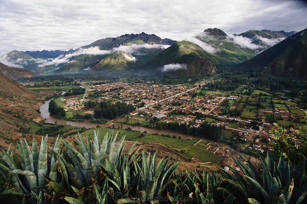 View of the Chicon glacier in the far distance and the town of Urubamba in the Urubamba River Valley, Peru.