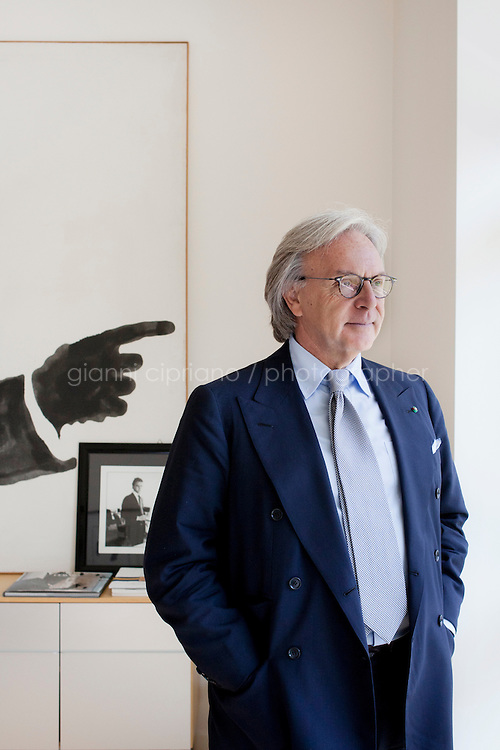 SANT'ELPIDIO A MARE, ITALY - MAY 20: Diego Della Valle, 57, President and CEO of Tod's, is here in his office in front of a Kennedy silhouette painting at the Tod's headquarters in Sant'Elpidio a Mare (FM, Marche), Italy, on May 20, 2011. The Tod's headquarters was designed by Della Valle's wife Barbara Pistilli and was inaugurated in 1998. Tod's Group is an Italian company which produces shoes and other leather goods, and is presided over by businessman Diego Della Valle. It is most famous for its driving shoes.<br /> <br /> Gianni Cipriano for Le Monde