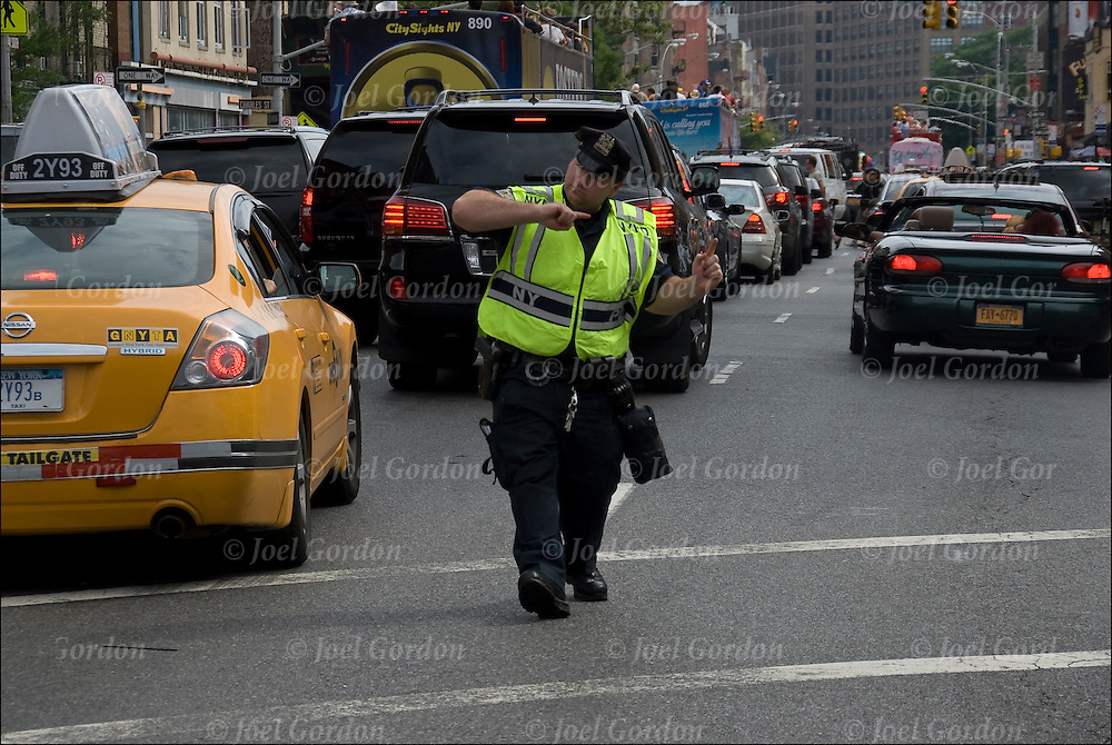 NYPD Police Officer on traffic duty on Seventh Avenue South in Greenwich Village during  Pride Parade in NYC.