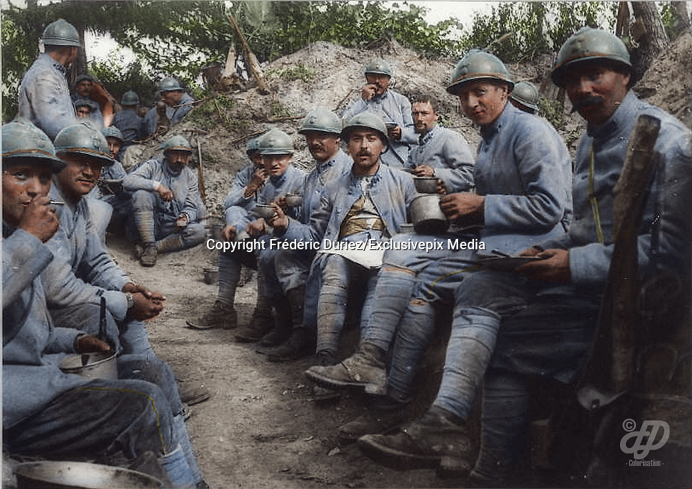 """Colorized photographs soldiers from the World War One<br /> <br /> With his impressive colorized photographs of the World War One, Frédéric Duriez gives us a new look at the conflict that ravaged the world between 1914 and 1918, revealing the difficult daily life of the French soldiers. <br /> <br /> Photo Shows: """"Bois des Buttes September 17, 1917 .<br /> The soup in the lines of the 204th Infantry Regiment .<br /> During this period the sector is """"""""quiet"""""""" . September 25 to 21:30 , the Germans sending a burst of 77 and kill 10 men of the 22th Company.<br /> ©Frédéric Duriez/Exclusivepix Media"""