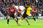 Troy Deeney (9) of Watford battles for possession with Steve Cook (3) of AFC Bournemouth during the Premier League match between Bournemouth and Watford at the Vitality Stadium, Bournemouth, England on 12 January 2020.