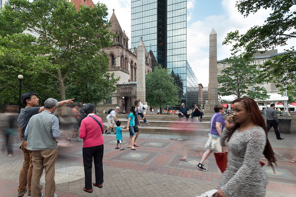 Taken Wednesday, July 22nd, 2015 from 5:55-6:30PM.  Found and &copy; by Mike Ritter.<br /> <br /> This is the backside of the Copley Square fountain with Trinity Church and the Hancock Tower (now officially known as 200 Clarendon), two of Boston&rsquo;s most famous buildings, in the background.  The fountain marked the rededication of Copley Square on June 22nd, 1989, capping the Copley Square Centennial Committee&rsquo;s renovation efforts beginning in 1983.  Locals bustle by after work while tourists take in the famous urban park.  The stage for the Boston Summer Arts Weekend is being set which would see the performances of Aaron Neville and Emmylou Harris.  I was happy to see a few skateboarders make an entrance late in the shoot as they are regulars at the fountain in the summer &ndash; even if they&rsquo;re not supposed to