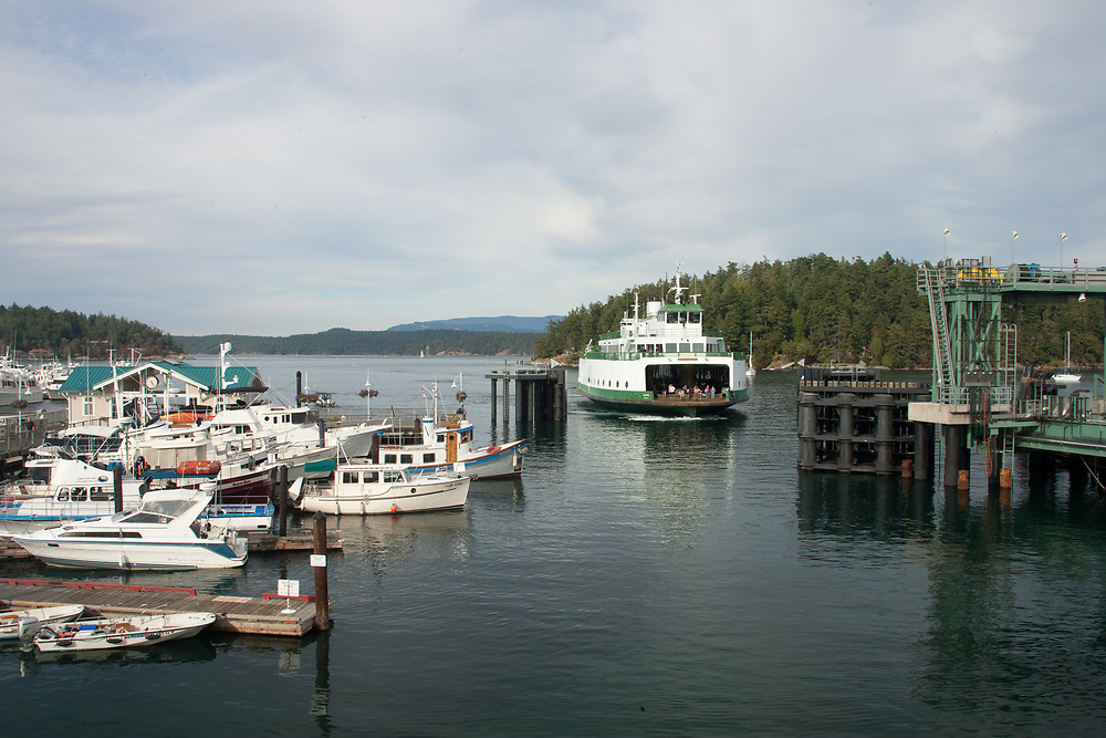 United States, Washington, San Juan Island, Friday Harbor. ferry coming into pier at the Port of Friday Harbor.