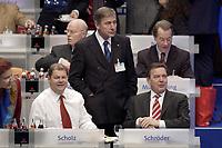 17 NOV 2003, BOCHUM/GERMANY:<br /> Olaf Scholz (L), SPD Generalsekretaer, Wolfgang Clement (M), SPD, Bundeswirtschaftsminister, und  Gerhard Schroeder (L), SPD, Bundeskanzler, im Gespraech, SPD Bundesparteitag, Ruhr-Congress-Zentrum<br /> IMAGE: 20031117-01-030<br /> KEYWORDS: Parteitag, party congress, SPD-Bundesparteitag, Gerhard Schröder