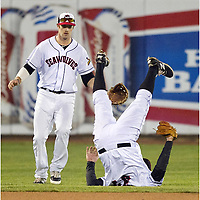 Erie SeaWolves outfielder Connor Harrell watches as third baseman Wade Gaynor flips backward after making a catch to close out the top of the seventh inning of a baseball game against the Bowie Baysox at Jerry Uht Park on Monday, April 27, 2015, in Erie, Pa. Bowie won 4-0. (AP Photo/Erie Times-News, Andy Colwell)