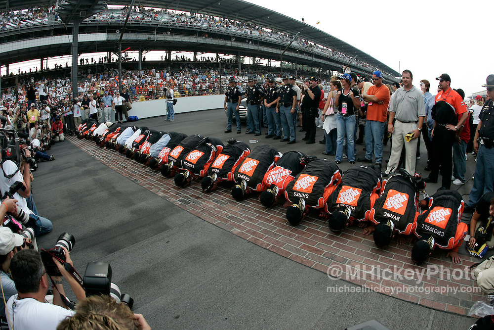 Tony Stewart's crew kisses the bricks after winning the Allstate 400 at the Brickyard Aug 7, 2005 in Indianapolis, IN.