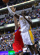 March 14, 2012; Indianapolis, IN, USA; Indiana Pacers center Roy Hibbert (55) shoots the ball against the Philadelphia 76ers at Bankers Life Fieldhouse. Indiana defeated Philadelphia 111-94. Mandatory credit: Michael Hickey-US PRESSWIRE