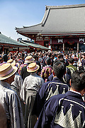 Pilgrims dressed in traditional garments during a Shinto festival. Sanja Matsur (Three Shrine Festival), is an annual Shinto festival held in Tokyo. The earliest form of the festivals dates back to the 7th century CE and is held in honor of Hinokuma Hamanari, Hinokuma Takenari and Hajino Nakatomo, the three men who established and founded Sensō-ji temple. Sanja Matsuri is held on the third weekend of every May at Asakusa Shrine. Its  parades revolve around three mikoshi (three portable shrines referenced in the festival's name), as well as traditional music and dancing.