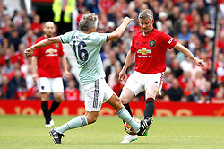 Manchester United Legends Ole Gunnar Solskjaer (right) and Bayern Munich Legends Andrea Otti battle for the ball during the legends match at Old Trafford, Manchester.