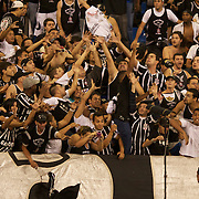 Corinthians fans jostle for a players shirt thrown into the crowd at the Olympic Stadium after the Fluminense V Corinthians, Futebol Brasileirao League match at the Olympic Stadium, Corinthians won the match 2-1. Rio de Janeiro. Brazil. 15th September 2010. Photo Tim Clayton.