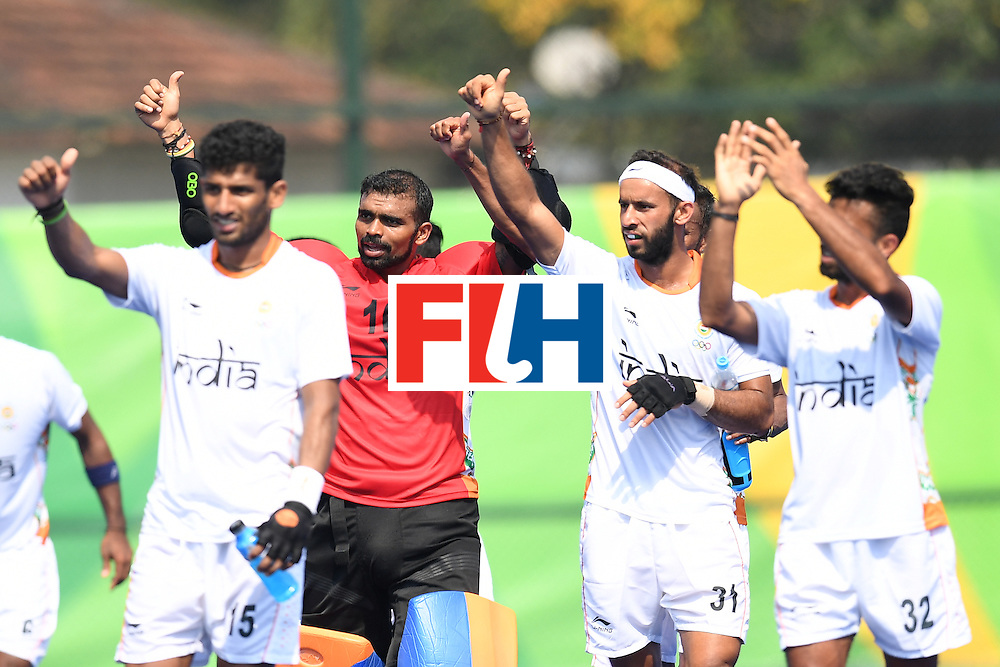 India's Sreejesh Parattu (2L) celebrates with his teammates after the men's field hockey Argentina vs India match of the Rio 2016 Olympics Games at the Olympic Hockey Centre in Rio de Janeiro on August, 9 2016. / AFP / MANAN VATSYAYANA        (Photo credit should read MANAN VATSYAYANA/AFP/Getty Images)