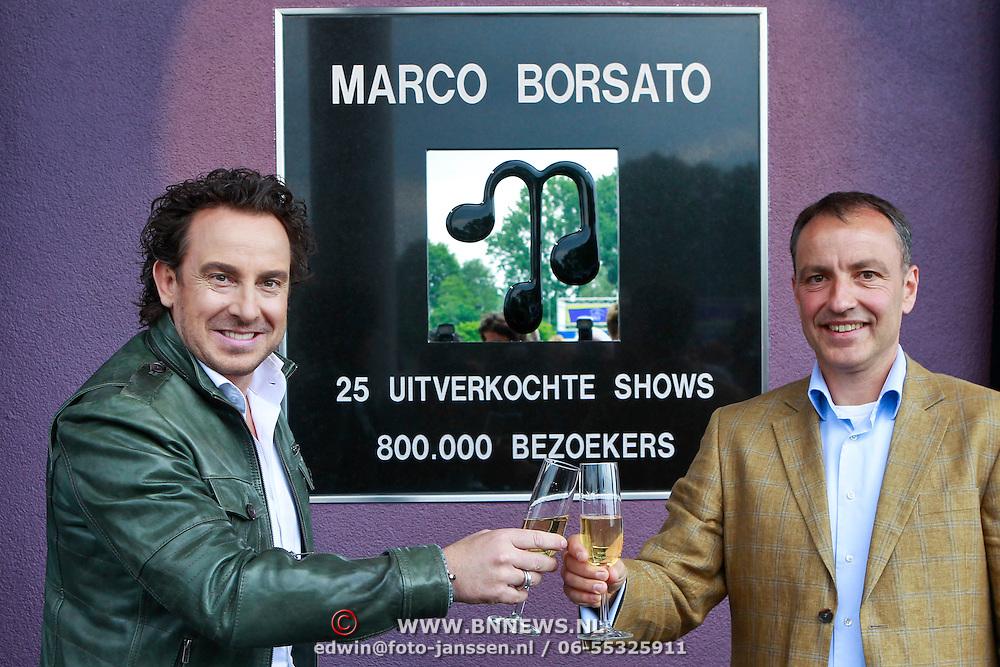 NLD/Arnhem/20110513 - Marco Borsato krijgt speciale tegel in het Gelredome, onthulling samen met directeur Gelredome Jasper van Amstel
