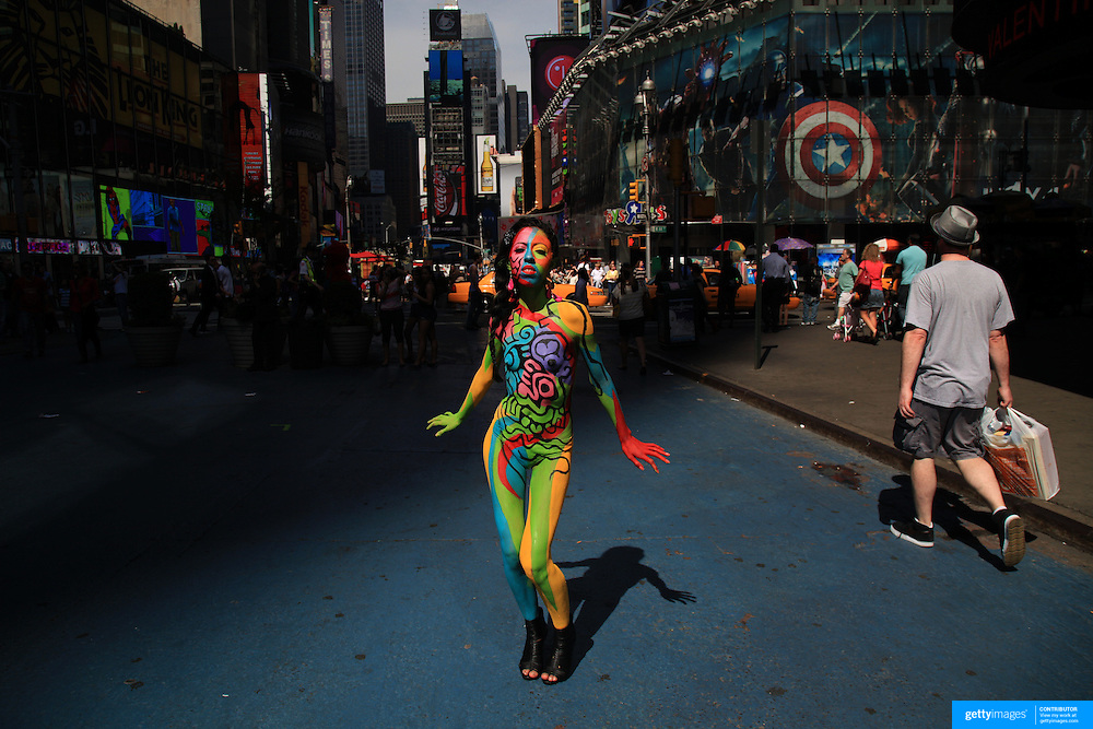 A New York model displays the work of New York body painter Andy Golub in Time Square,  New York, USA. 17th March 2012. Photo Tim Clayton