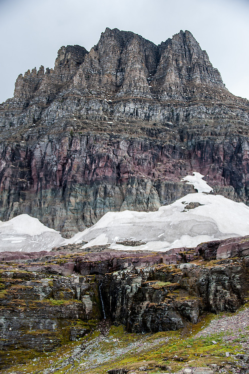 A small waterfall in the rock at the base of a snowfield at Mount Clements at Logan Pass, Glacier National Park, Montana, Tuesday, October 7, 2014. According to Dan Fagre Ph.D. of the USGS receding glaciers in the park means that streams dry up in late summer and fall.