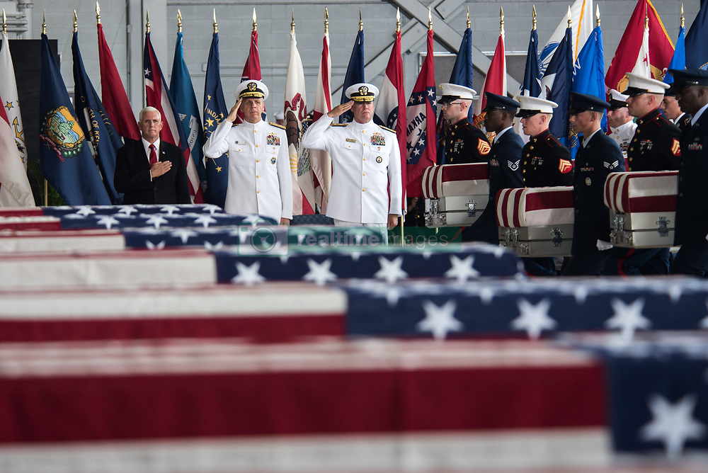JOINT BASE PEARL HARBOR-HICKAM, Hawaii (Aug. 1, 2018) The Defense POW/MIA Accounting Agency (DPAA) and U.S. Indo-Pacific Command conduct an honorable carry ceremony at Joint Base Pearl Harbor-Hickam, Hawaii, Aug. 1, 2018. Carry teams will move fifty-five transfer cases, containing what are believed to be the remains of American service members lost in the Korean War, to the DPAA facility at Joint Base Pearl Harbor-Hickam for identification. North Korea recently turned over the remains to the U.S. and is the first mass turnover of remains since the early '90s. (U.S. Air Force photo by Senior Airman Apryl Hall/Released)180801-F-AN072-0142