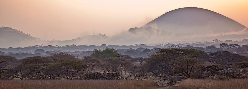 Panorama of morning mist and glowing sunrise over the Chyulu Hills, Kenya, Africa (photo by Wildlife Photographer Matt Considine)