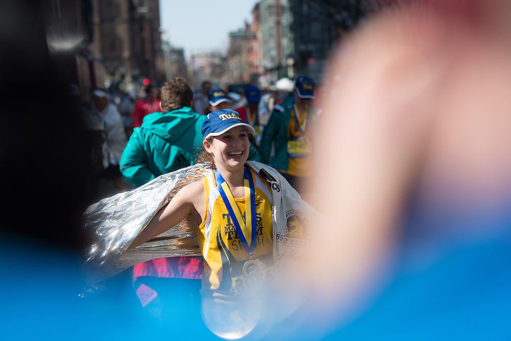 4/18/16 – Boston, MA – Shoshana Weiner (LA'16) walks away from the finish of the 2016 Boston Marathon on April 18, 2016. (Sofie Hecht / The Tufts Daily)