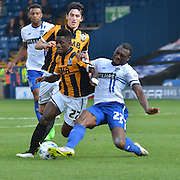 the two 27's battle for the ball during the Sky Bet League 1 match between Bury and Port Vale at Gigg Lane, Bury, England on 19 September 2015. Photo by Mark Pollitt.