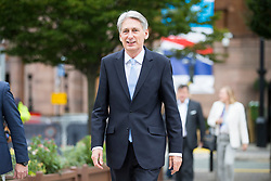 © Licensed to London News Pictures. 04/10/2017. Manchester UK. Chancellor Philip Hammond leaves the Midland hotel this morning ahead of Theresa May's speech on the third & final day of the Conservative Party Conference today in Manchester. Photo credit: Andrew McCaren/LNP