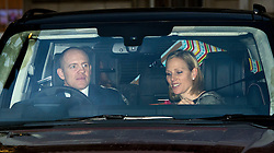 © Licensed to London News Pictures. 16/12/2015. London, UK. Zara Phillips and Mike Tindall leaving Buckingham Palace with presents in the back seat following a Christmas lunch with the queen and other members of the royal family. Photo credit: Ben Cawthra/LNP