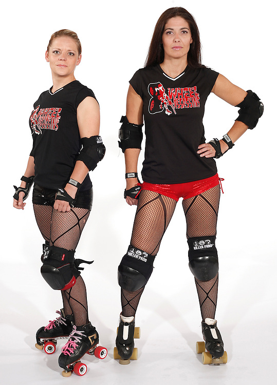 Colleen Quirion (left) and Yvette Gonzales are members of the 8 Wheel Assassins, the top travel team for the Cherry City Derby Girls.