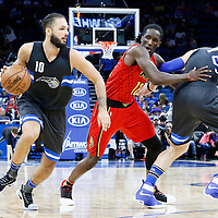 25 February 2017: Orlando Magic guard Evan Fournier (10) drives past Atlanta Hawks forward Taurean Prince (12) on a screen set by Orlando Magic center Nikola Vucevic (9) during the Orlando Magic 105-86 victory over the Atlanta Hawks, at the Amway Center, Orlando, Florida, USA.