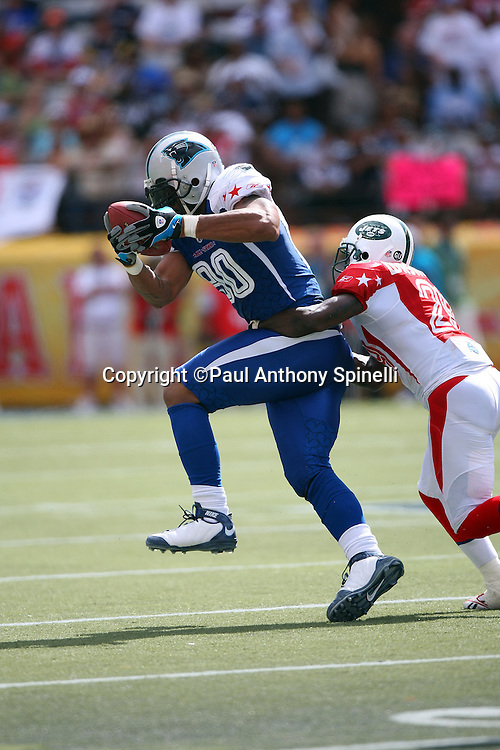 HONOLULU, HI - FEBRUARY 08: NFC All-Stars defensive end Julius Peppers #90 of the Carolina Panthers intercepts a late game pass and gets tackled by AFC All-Stars running back Leon Washington #29 of the New York Jets in the 2009 NFL Pro Bowl at Aloha Stadium on February 8, 2009 in Honolulu, Hawaii. The NFC defeated the AFC 30-21. ©Paul Anthony Spinelli *** Local Caption *** Julius Peppers;Leon Washington